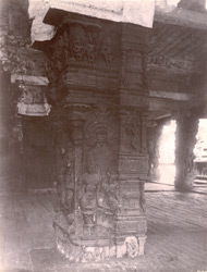 Close view of base of a carved pillar inside the front mandapa of the Rama Temple, Kumbakonam